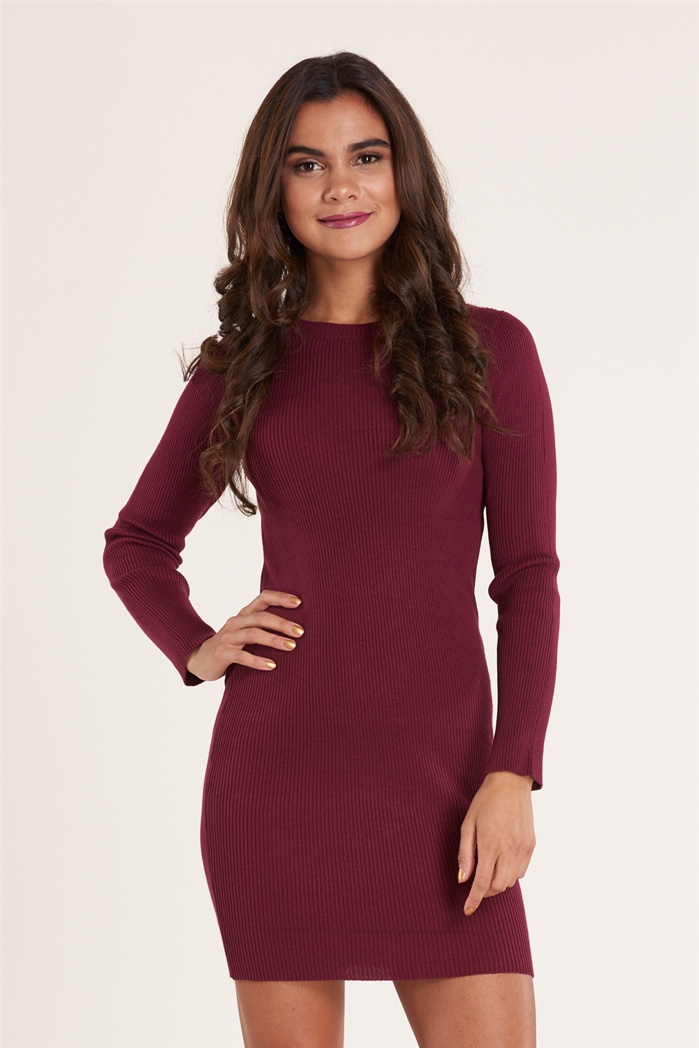 5755b5f6947 A ribbed knit dress features long sleeves